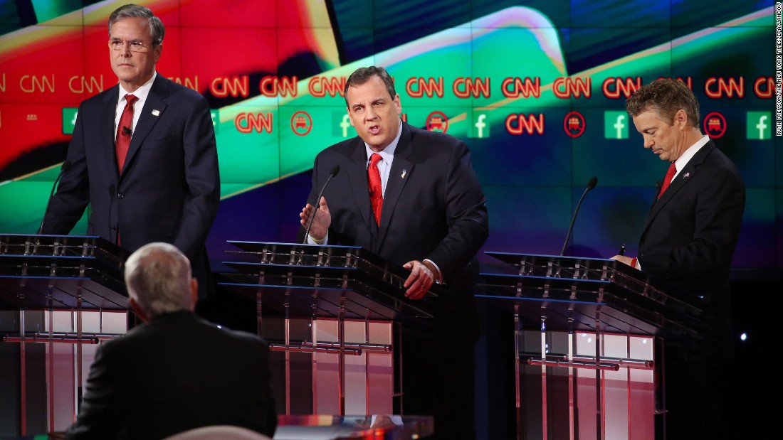 "New Jersey Gov. Chris Christie, center, makes a point between former Florida Gov. Jeb Bush, left, and U.S. Sen. Rand Paul. ""I'm a former federal prosecutor,"" Christie said during the debate. ""I've fought terrorists and won, and when we get back in the White House we will fight terrorists and win again and America will be safe."" Much of Tuesday night's debates focused on national security and the ISIS terror threat."