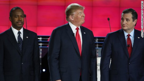 Ben Carson, Donald Trump and Ted Cruz stand on stage during the CNN Republican presidential debate on December 15, 2015 in Las Vegas, Nevada.