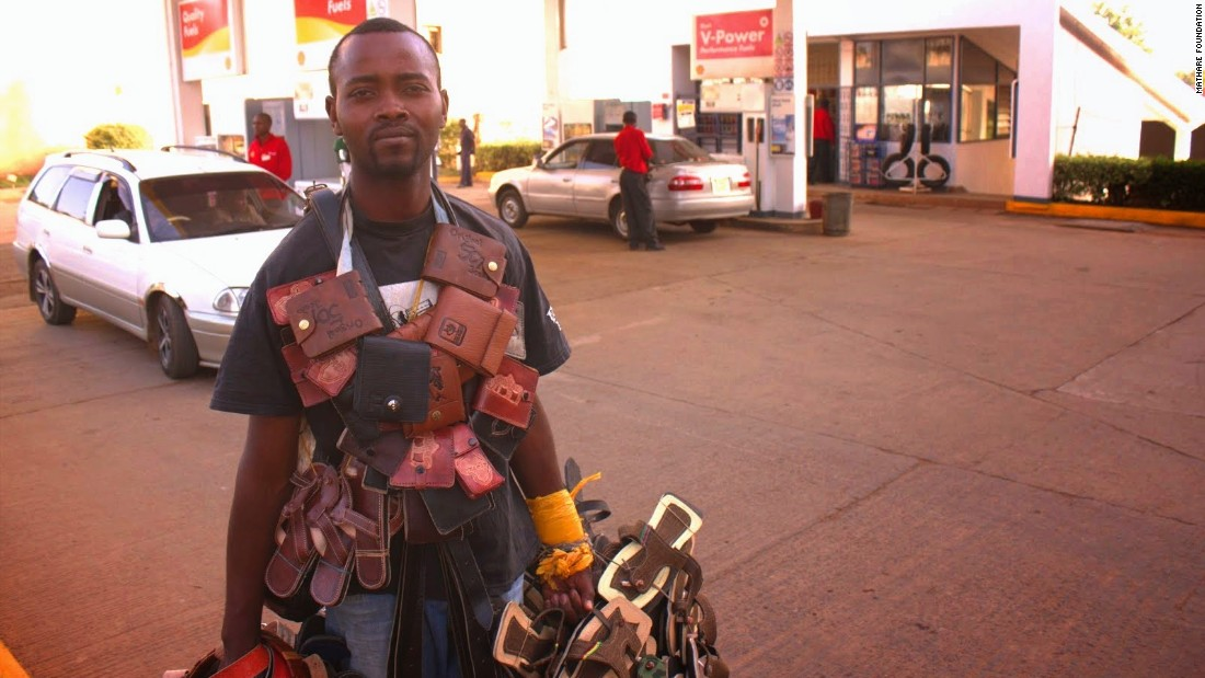 Students have also documented the informal economy which supports many poor people in Kenya. Here, a man sells wallets and sandals at a gas station in Kiambu, near Nairobi.