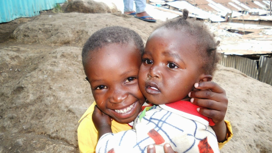 This photograph of two siblings clutching each other in an embrace shows that love endures in the slums, despite the other evident hardships.