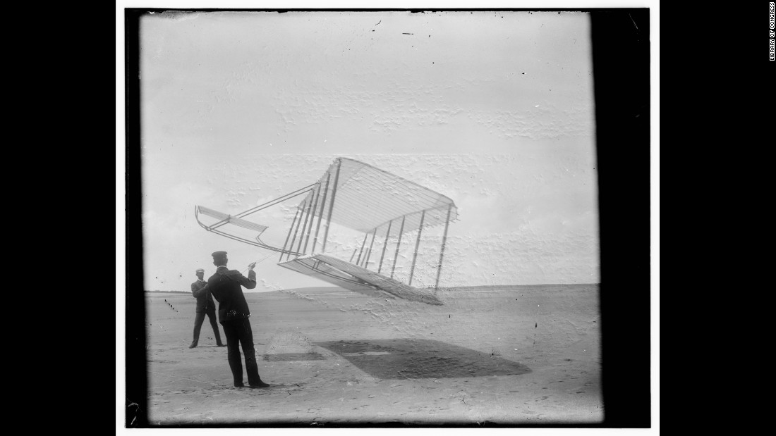 Wilbur, left, and Orville fly a glider like a kite in 1901. They tested gliders for a few years before their historic flight in Kitty Hawk.