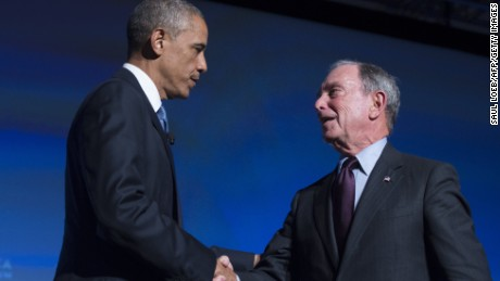 US President Barack Obama shakes hands with former New York City Mayor Michael Bloomberg during the US - Africa Business Forum on the sidelines of the US - Africa Leaders Summit in Washington, DC, August 5, 2014.