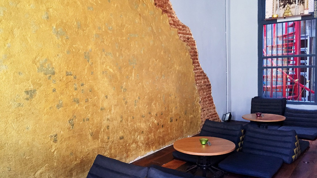 Swaths of gold-covered brick are exposed amongst otherwise concrete walls at Tep. It's a nod to ancient times when the Siamese buried golden Buddhas in cement to hide them from invaders.