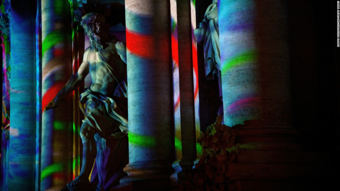 The 18th-century Baroque-style Trevi Fountain is lit with colors as part of Rome's canditature for the 2024 Olympic Games.