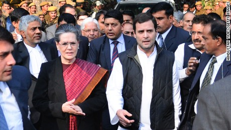 Congress party president Sonia Gandhi and her son Rahul Gandhi leave court after being granted bail.