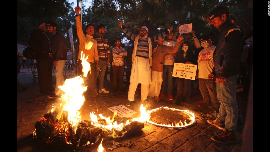 Protesters shout slogans as they burn an effigy of the juvenile convicted in the gang rape case during a protest in New Delhi on December 16, the third anniversary of the incident.