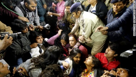 The Delhi Police detain the mother of the victim, along with protestors in New Dehli.