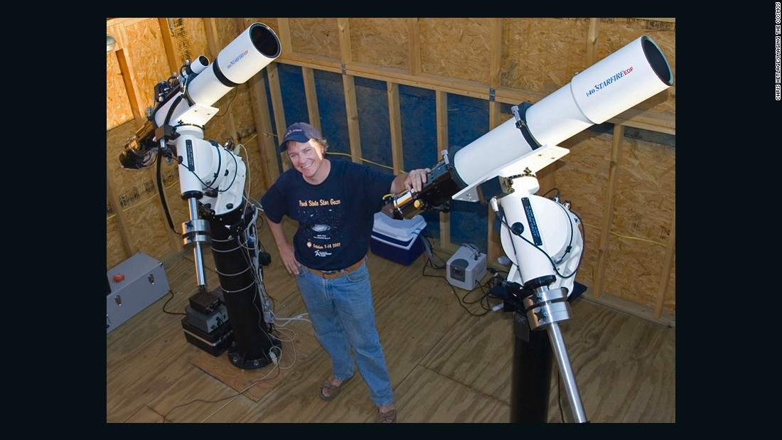 Chris Hetlage, one of the co-founders of the Deerlick Astronomy Village, poses with his telescopes at his observatory.