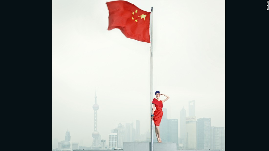 This photo is part of the 'Long live the Motherland' series that appeared in Vogue in 2010. The Shanghai skyline appears in the background.