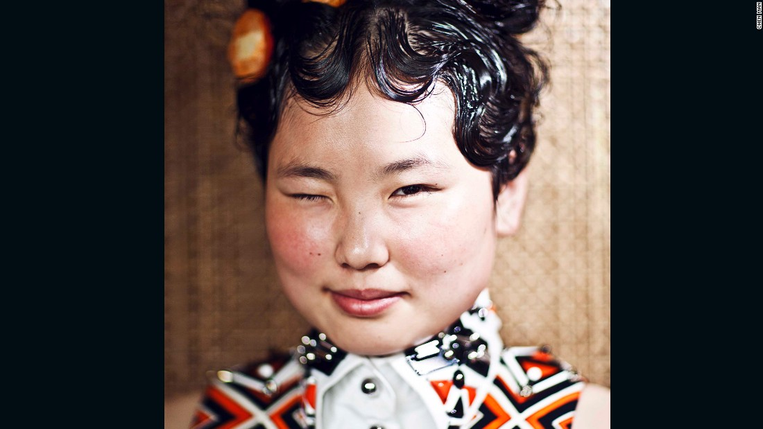 This portrait of a waitress at a vegetarian restaurant, was shot in 2012 for i.D. The series depicted China's ethnic minorities.