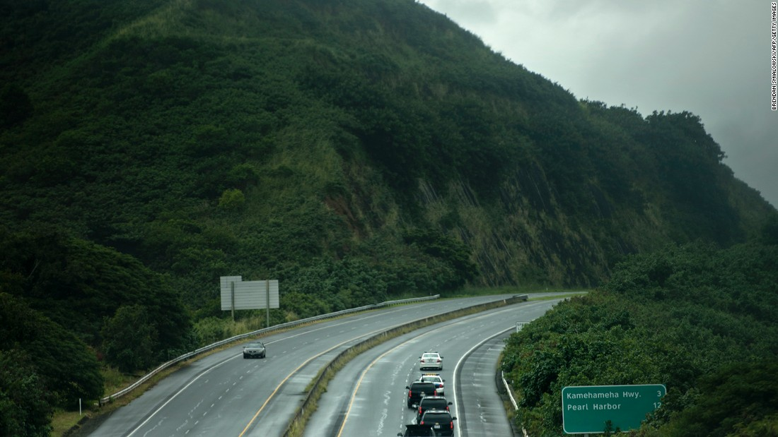 A motorcade takes the Obama family to a hike on Sunday, December 20, in Honolulu.