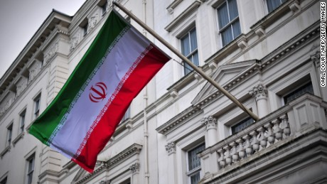 The Iranian flag hangs outside the Iranian embassy in central London on February 20, 2014. Iran and Britain officially resumed Thursday diplomatic relations severed by London after students stormed its Tehran embassy in 2011, a senior Iranian official said.