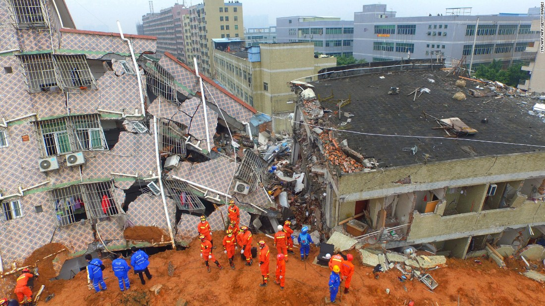 Chinese rescuers work at the land slidesite. The landslide that hit southern China's Shenzhen on December 20, 2015 was China's second industrial disaster in four months.