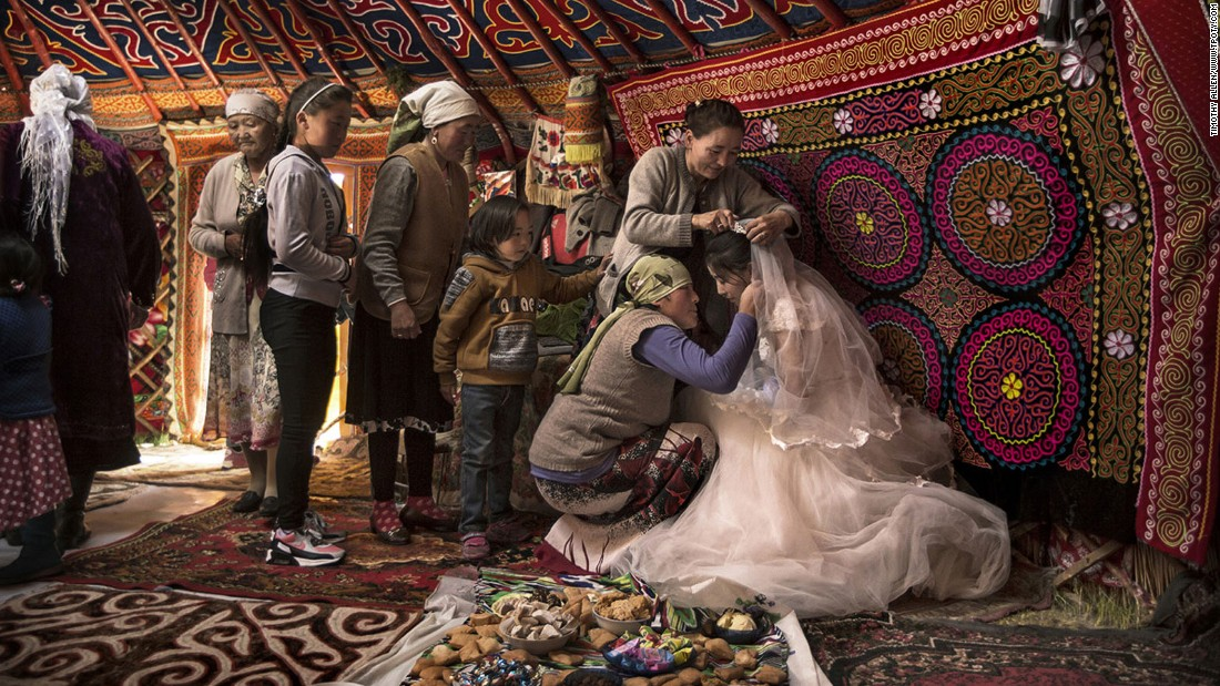 "Another Brit, Tim Allen, earned a ""faces, people, encounters"" runner-up prize for this image of Kazakh wedding season in Western Mongolia's Altai Mountains, Western Mongolia.(Photo Tim Allen/www.tpoty.com)"