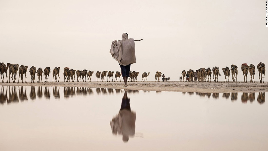 "Another ""water"" category winner shows salt flats in the Danakil Depression in Ethiopia's Afar region. Portuguese photographer Joel Santos's image shows a salt miner taking a camel caravan to a mining site.(Photo: Joel Santos/www.tpoty.com)"