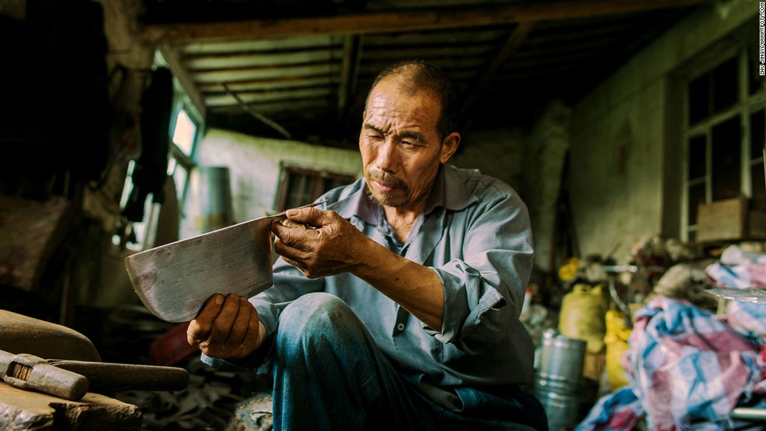 "Chinese photographer Zhu Jingyi scooped the competition's ""new talent"" prize for a series of images depicting street culture of Jiangsu, the province to the north of Shanghai. Among his subjects is this blacksmith. (Photo: Zhu Jingyi/www.tpoty.com)"