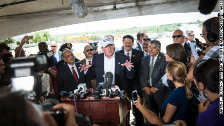 Trump talks to the media along the U.S. Mexico border during his trip to the border on July 23, 2015 in Laredo, Texas. Trump's recent comments, calling some immigrants from Mexico as drug traffickers and rapists, have stirred up reactions on both sides of the aisle. Although fellow Republican presidential candidate Rick Perry has denounced Trump's comments and his campaign in general, U.S. Senator from Texas Ted-Cruz has so far refused to bash his fellow Republican nominee.