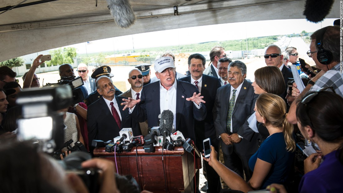 "Trump talks to the media along the U.S.-Mexico border during a trip to Laredo, Texas, on July 23. This is where <a href=""http://www.cnn.com/2015/07/23/politics/donald-trump-hat-border-tour-laredo/"">Trump first premiered</a> his ""Make America Great Again"" hat."