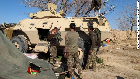 Afghan National Army (ANA) soldiers prepare for combat during an ongoing battle with Taliban militants in the Nad Ali district of Helmand on December 22, 2015. Military planes have dropped food and ammunition to besieged Afghan forces battling to push Taliban insurgents out of Sangin, officials said December 22, two days after the emboldened militants stormed the opium-growing district. Islamists have captured large swathes of the district in the southern province of Helmand which British and US forces struggled for years to defend.Fleeing local residents reported bloody gunfights as the Taliban advanced on the district centre, highlighting a worsening security situation across Afghanistan a year after NATO formally ended its combat operations. AFP PHOTO / Noor Mohammad / AFP / NOOR MOHAMMAD        (Photo credit should read NOOR MOHAMMAD/AFP/Getty Images)