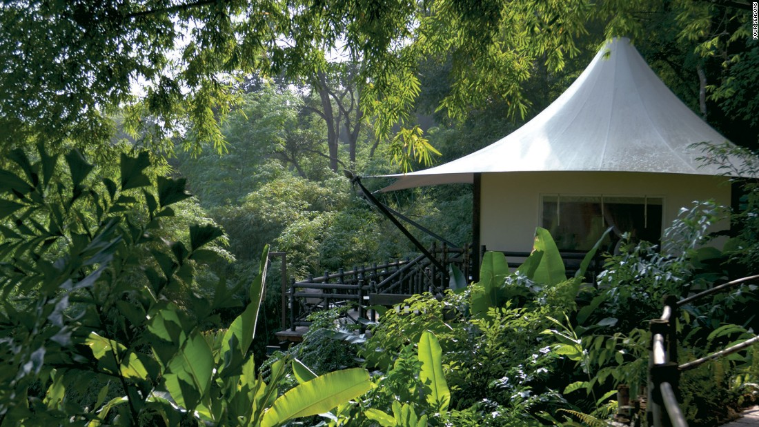"<strong>Four Seasons Tented Camp, Thailand</strong>: This luxury ""camp"" is built on a cliffside overlooking the Ruak River in northern Thailand, surrounded by the jungles and mountains and elephants roaming freely."