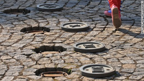 A child walks on a sundial on a square in Trest, Czech Republic.