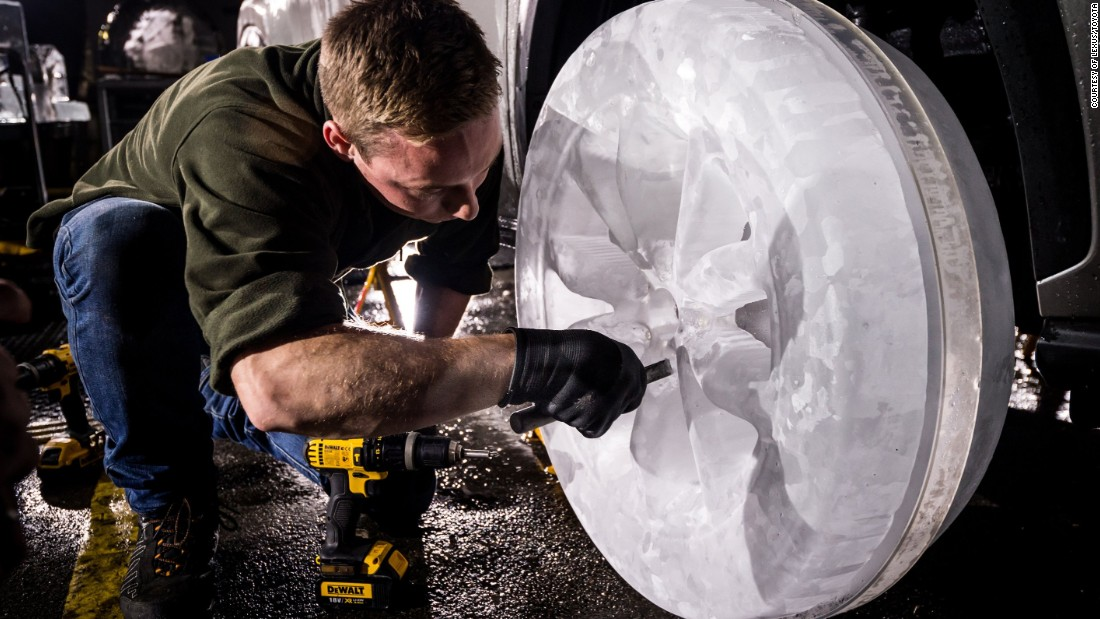 Ice sculptors carefully install their handcrafted wheels onto the car after spending up to 36 hours on each one.