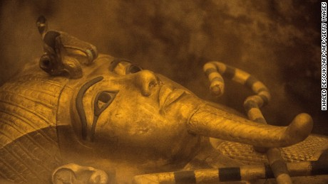 A picture taken on November 28, 2015 shows the sarcophagus of King Tutankhamun displayed in his burial chamber in in the Valley of the Kings, close to Luxor, 500 kms south of the Egyptian capital, Cairo. Scans in King Tutankhamun's tomb in Egypt's Valley of the Kings point to a hidden chamber, the country's antiquities minister said Saturday, possibly heralding the discovery of Queen Nefertiti's resting place. AFP PHOTO / KHALED DESOUKI / AFP / KHALED DESOUKI        (Photo credit should read KHALED DESOUKI/AFP/Getty Images)