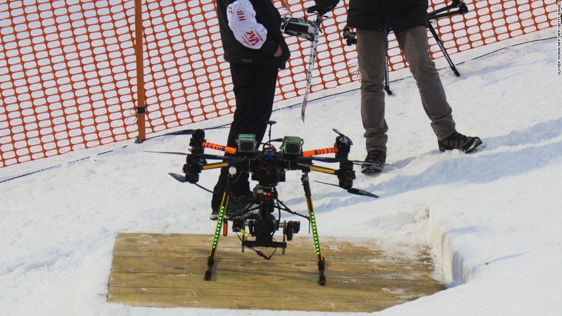 The drone fitted with a camera -- shown here prior to its crash -- landed just inches behind him at the top of the slope.<br />