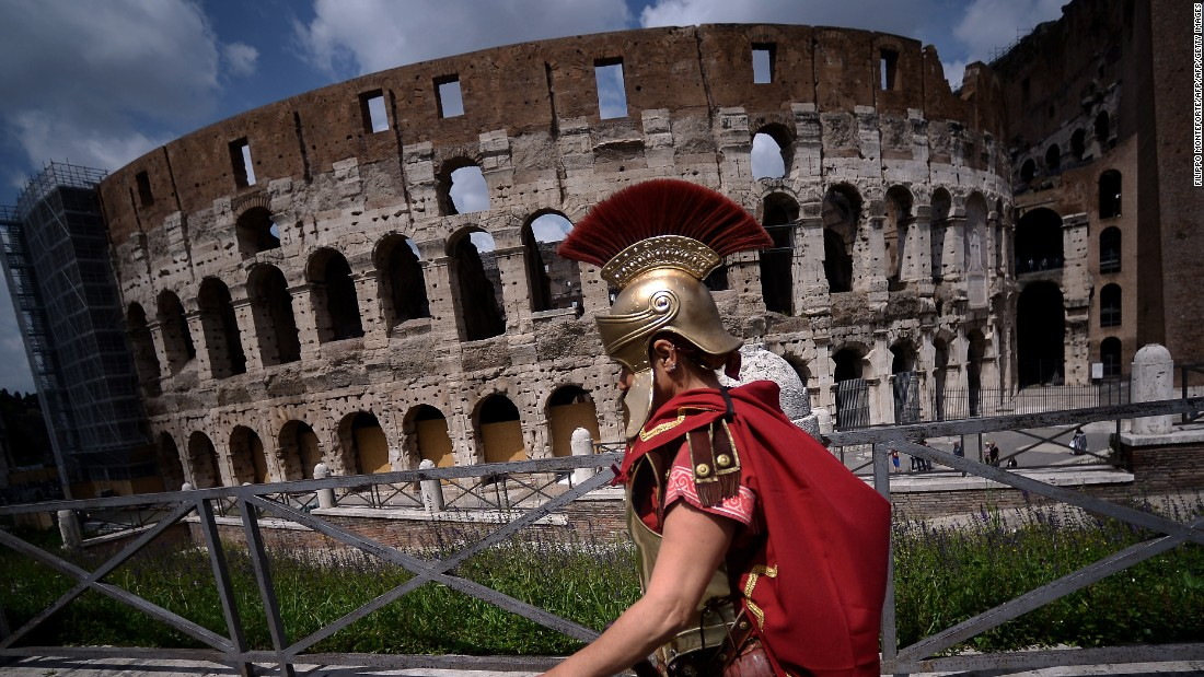 <strong>Rome, Italy: </strong>The Colosseum -- a nearly 2,000-year-old stadium in the middle of a modern city -- is one of the sites that reminds visitors of Rome's glorious (and gruesome) old era.