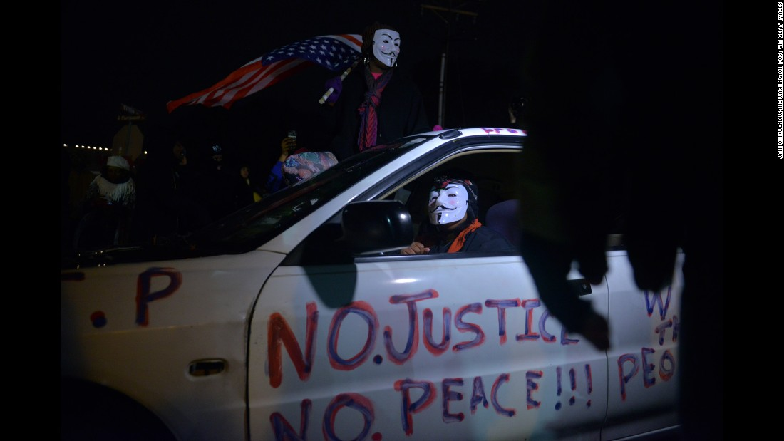 "Protests and clashes with police after the officer wasn't indicted in the death of Michael Brown in Ferguson led to another round of protests, with the rallying cry ""No justice, no peace."""