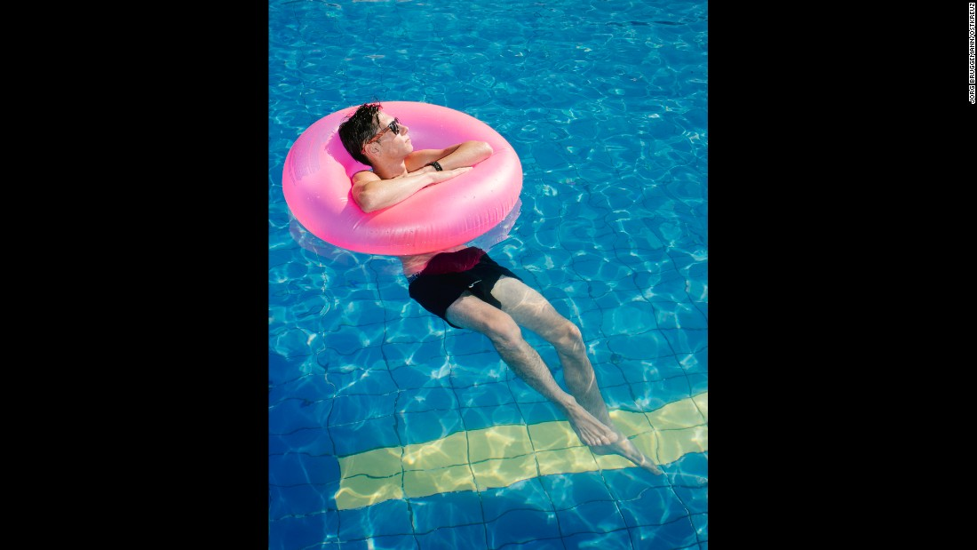 A tourist swims in a pool at the Kos Palace hotel.