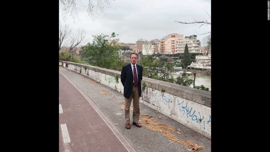 A Prati district resident, north of Rome, walks along the Tiber Cycling Lane.