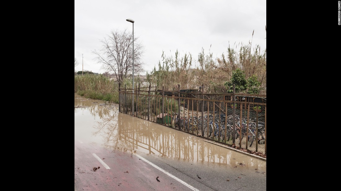 A flooded bike-rental shop near the Ponte Milvio area.