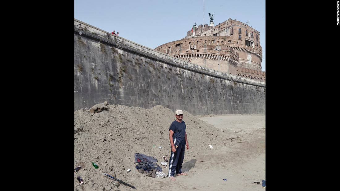 A man fishes along the Tiber Cycling Lane, just below Castel Sant'Angelo, one of the residences of the Pope.