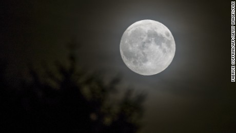 A full moon is seen in Lausanne, Switzerland, in September. Look for one on Christmas morning.
