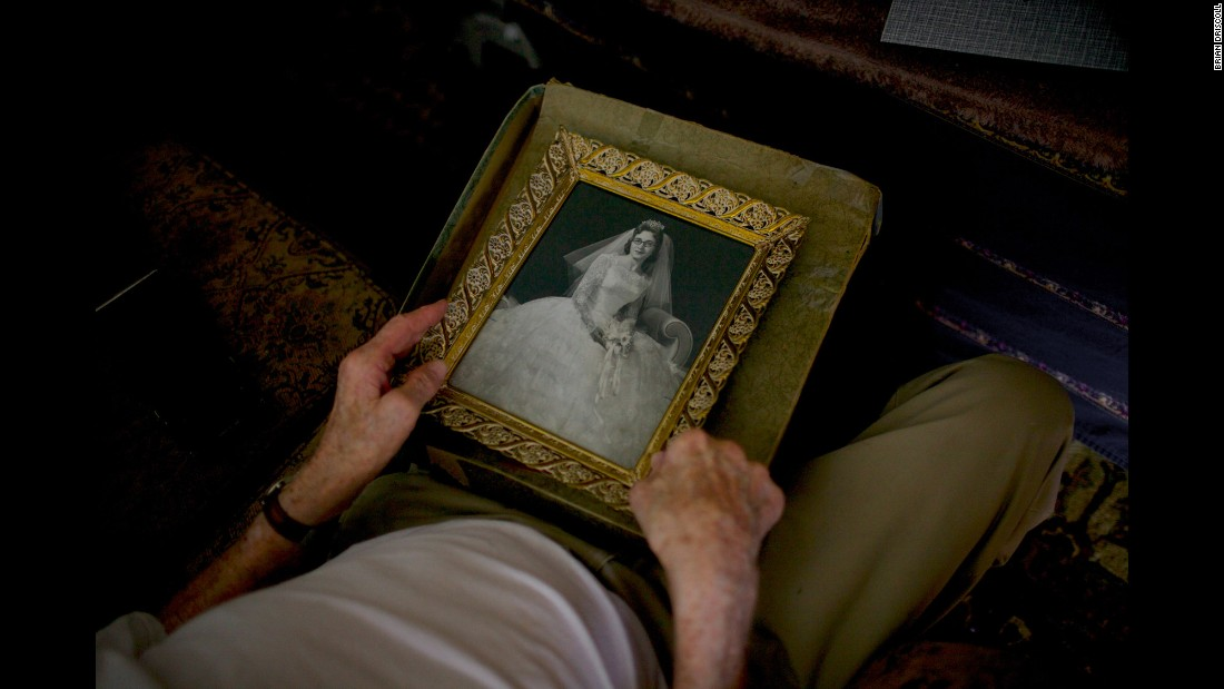 Frampton holds a photo of his wife, Theresa, in her wedding dress in 1956.
