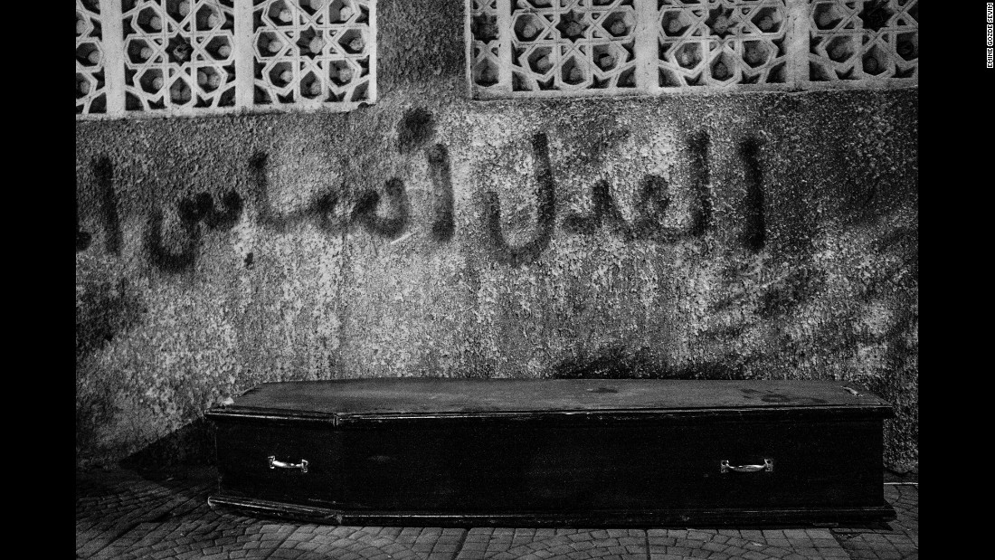 "Graffiti behind this coffin says ""Justice is the foundation of authority."" This photo was taken in the Shobra neighborhood of Cairo."