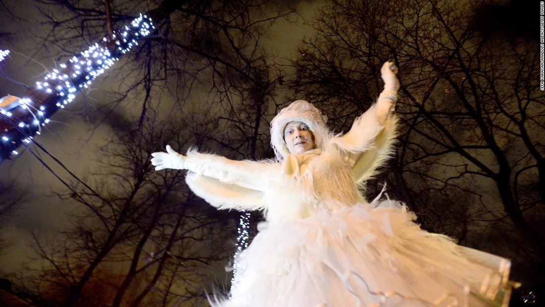 A  costumed woman joins a Christmas parade at Pushkinskaya Square in Moscow on Thursday.