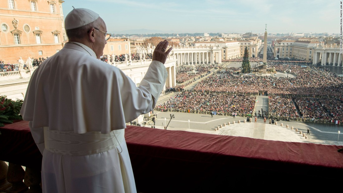Pope Francis delivers his blessing from the central balcony of St. Peter's Basilica at the Vatican on Christmas Day.