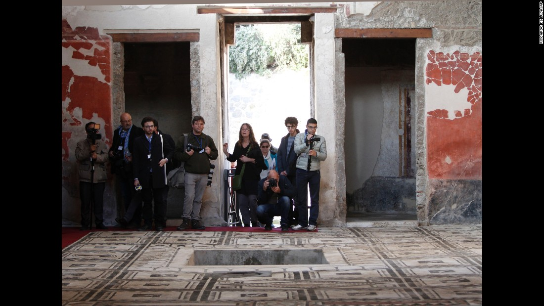 Journalists take photos in the Casa di Paquius Proculus.