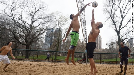 The shirts come off on Christmas Eve as a group plays volleyball in New York's Central Park.