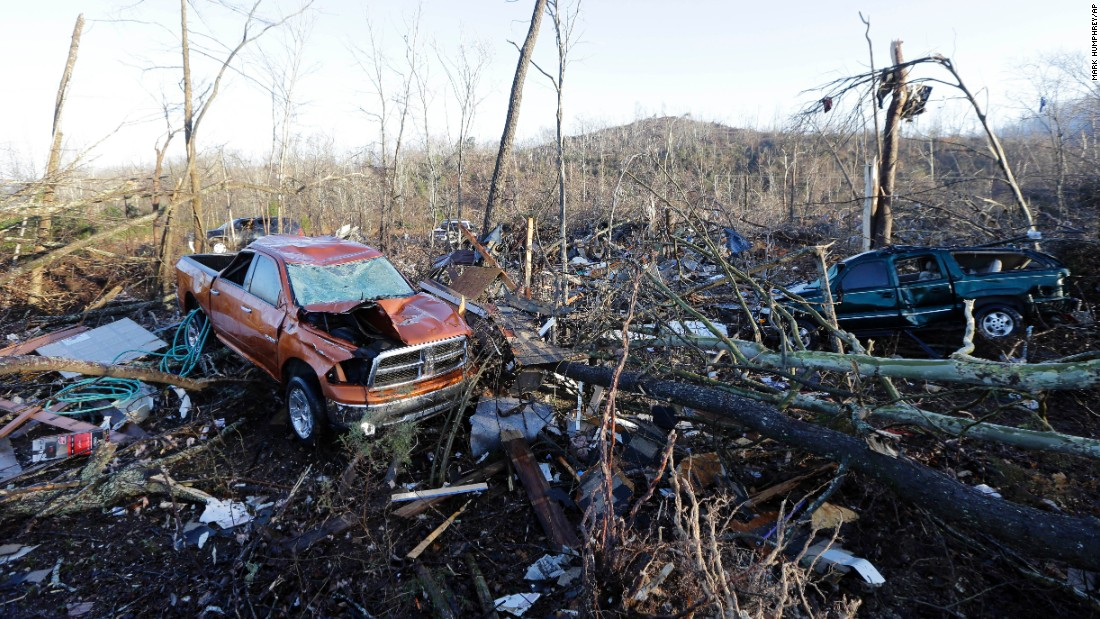 Vehicles and debris are scattered near Linden, Tennessee, on Thursday after a tornado charged through, leaving a trail of destruction.