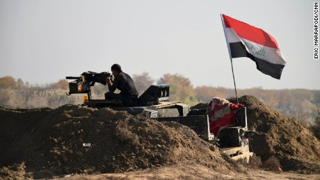 Iraqi Security forces with national flag enter downtown Ramadi, 70 miles (115 kilometers) west of Baghdad, Iraq, Sunday, Dec. 27, 2015. Islamic State fighters are putting up a tough fight in the militant-held city of Ramadi, slowing down the advance of Iraqi forces, Gen. Ismail al-Mahlawi, head of the Anbar military operations, said Sunday. (AP Photo)