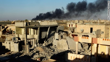 In this Friday, Dec. 25, 2015 photo, smoke rises from Islamic State positions following a U.S.-led coalition airstrike as Iraqi Security forces advance their position in downtown Ramadi, 70 miles (115 kilometers) west of Baghdad. Iraqi forces entered the Huz at dawn, an area housing a government compound in the center of Ramadi, part of a major offensive aimed at dislodging the Islamic State terrorist militia from the western city, an Iraqi official said. (AP Photo)