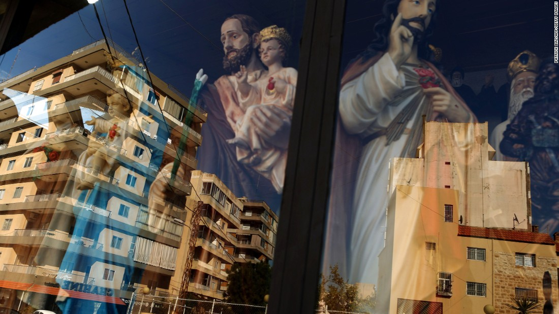 Christmas is a big deal in Lebanon, where well over a third of the population is estimated to be Christian. Both secular and religious festive decorations can be found across the country, like these figures reflected in a shop window.