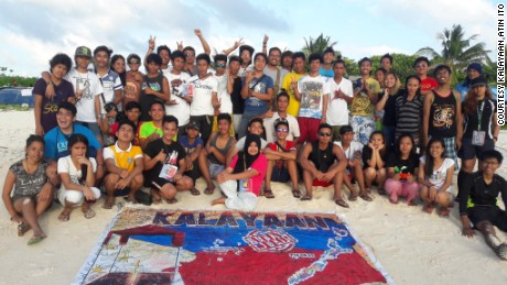 Some 47 young Filipino activists landed on a smal disputed island in the South China Sea Saturday.