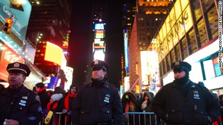 New York Police Department patrol in Times Square on December 31, 2014 in New York City. With an estimated one million people packing into Times Square and elsewhere around the city, New York has stepped up security measures.