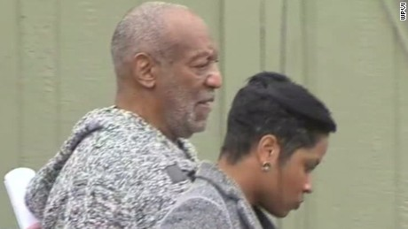 Bill Cosby leaves police station after booking
