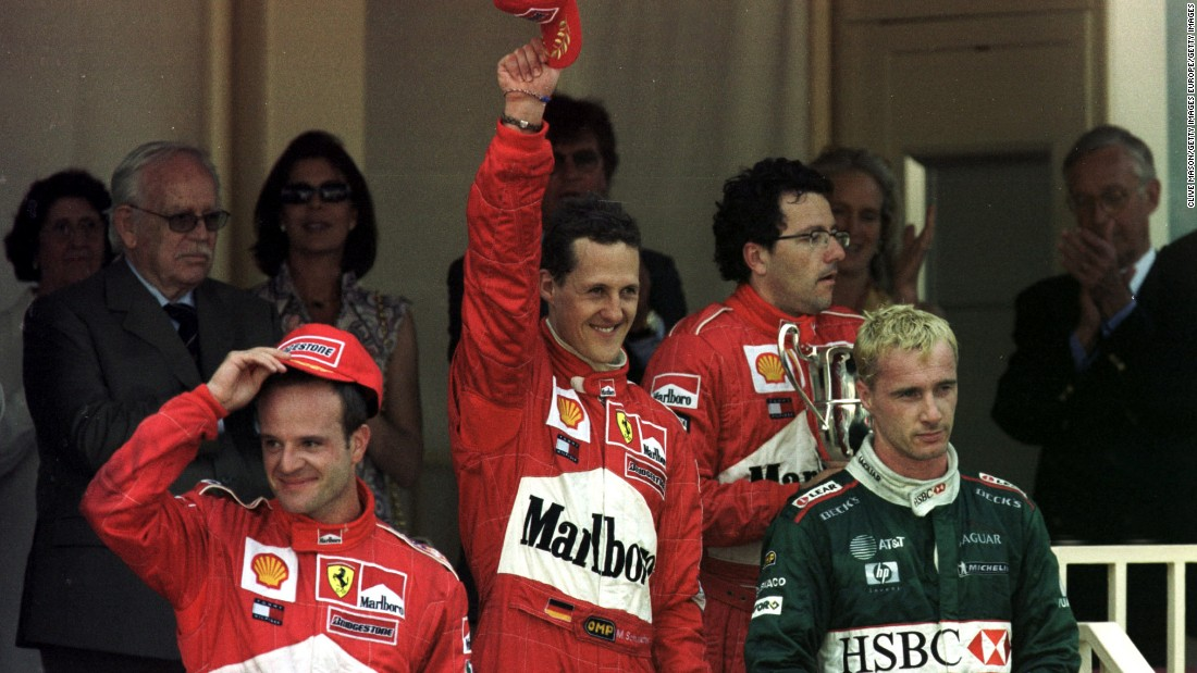 Jaguar raced to third place twice in its F1 history. Here a bleached blond Irvine climbs onto the podium at the 2001 Monaco Grand Prix alongside Rubens Barrichello (left) and  Michael Schumacher  (center).