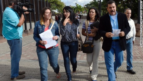 "(L-R) Venezuelan opposition deputies Amelia Belisario,  Melva Paredes, Mariela Magallanes and Simon Calzadilla leave the Supreme Court of Justice in Caracas on December 30, 2015. The ruling United Socialist Party of Venezuela (PSUV) filed court challenges on Monday and Tuesday contesting the election of eight lawmakers. It added a ninth challenge Wednesday. Venezuela's opposition urged the international community Wednesday to prevent what it alleged was an attempt by President Nicolas Maduro to mount a ""judicial coup.""  AFP PHOTO/JUAN BARRETO / AFP / - / JUAN BARRETO        (Photo credit should read JUAN BARRETO/AFP/Getty Images)"